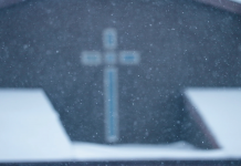 a faded image of a cross, a symbol of spirituality for christians.